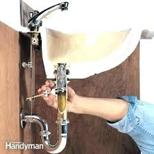 slow draining bathroom sink slow draining bathroom sink slow draining bathroom sink repair unclog a without chemicals family handyman 2 slow draining
