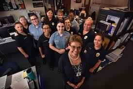 vicky lawton records division manager for the garden grove pd front center with members of the ggpd records division and front desk csos munity