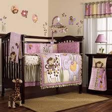 gray baby girl nursery wooden platform black crystal chandelier beige roll blind beige carpet gray nursery ideas