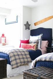 red and blue boys bedroom with blue gingham duvet covers