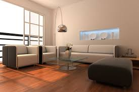 simple living room. simple living room with redish-brown wood flooring, white and dark grey furniture,