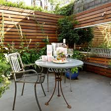 Patio with mirror small garden ideas David Still
