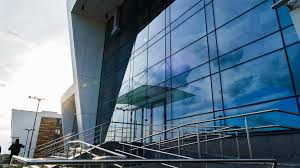 office glass windows. Office Building With Glass Windows Which Reflect The Floating Clouds, Along There Are People. Timelapse Stock Video Footage - VideoBlocks E