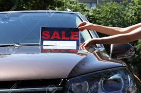 For Sale Sign On Car Hands Put A For Sale Sign On Windshield Of Car Stock Photo Picture