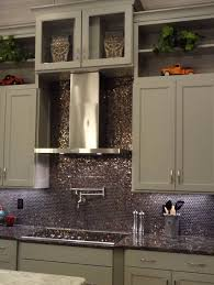awesome metallic penny tile backsplash along with gray kitchen cabinet
