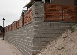concrete blocks wood fence retaining wall
