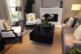 decorate living room with fireplace. Professional Design Living Room With White Fireplace, Rectangle Dark Block-style Coffee Table, Decorate Fireplace