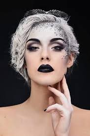 this fantasy makeup looks like an evil ice queen really like the colours and the bold black lips and eyebrows