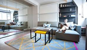 Studio flat furniture 300 Square Foot Masterclass On How To Create Space In Tiny Flats275sq Ft London Studio Flat Showcases Clever Spacesaving Design And Even Seats Eight For Dinner Homes And Property Masterclass On How To Create Space In Tiny Flats 275sq Ft London