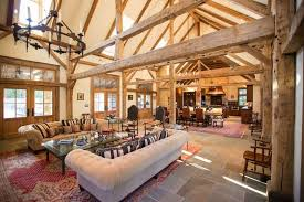 Barn to Home Conversion with Pennsylvania Blue Stone Floors and Antique  Timber Frame by Heritage Barns of Waco, Texas.