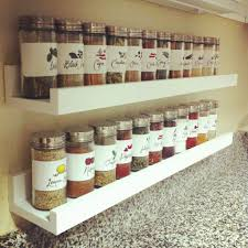 DIY spice rack! easy access, doesn't take up room in the cupboards ...