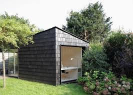 tiny backyard home office. every inch of this tiny backyard studio serves a purpose as office sleeping quarters home