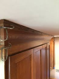 Crown Moulding Cabinets Hiding A Wavy Ceiling In Crown Molding