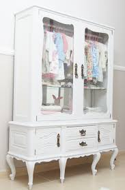 Repurpose a vintage china cabinet into a little girl's clothing ...