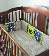 nautical baby nursery crib pers with anchors in navy blue lime green and grey