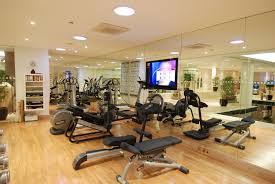Impressive Modern Style Home Gym Ideas with Large Wall Mirror and Wooden  Laminate Flooring also Recessed