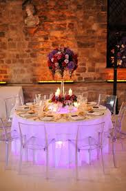 love the soft purple glow of this reception table create the look with