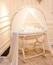 wooden baby bassinet antique ivory and golden color swing cradle bed luxury hand carving dark wood