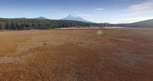 Grass field aerial Vector Aerial Drone View Of Dry Grass Field And Mount Shasta In Northern California Stock Video Footage Storyblocks Video Video Blocks Aerial Drone View Of Dry Grass Field And Mount Shasta In Northern