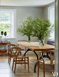 hand wegner chairs from the conran flank a custom made barrjoinery table in the kitchen pablo pico owned one of the dan masks
