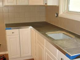 image of cool tile over laminate painting countertops to look like black granite kitchen