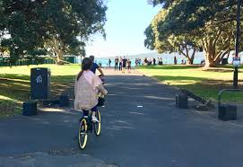 an april weekend at mission bay beach grab a share bike and go go go image bike auckland