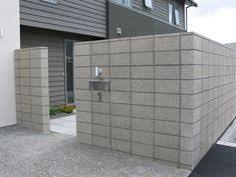 Small Picture Honed Grey Coloured Masonry Retaining Wall Sealed In a Wet Look