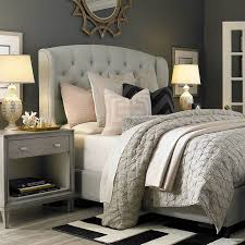 patterns and textures provide soft contrasts in a dramatic grey bedroom