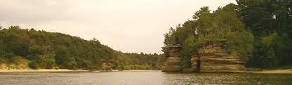 from wikipedia the dells of the wisconsin river a scenic glacially formed gorge that features striking sandstone formations along the banks of