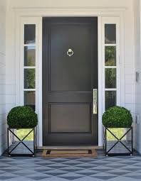 black front door with sidelightsBlack Front Door with Mirrored Planters  Transitional  Home Exterior