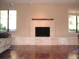 travertine tile face fireplace with raised hearth