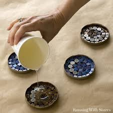 make a set of mosaic cocktail coasters that each propose a toast using clear resin
