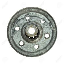 a broken garage door pulley with the ball bearings n out on a white background