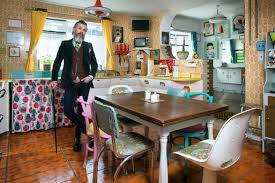 1950s house interior. musician ger eaton in his kitchen where everything is retro, even the tiles. 1950s house interior