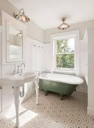 Traditional Full Bathroom with Wainscoting, Built-in bookshelf, penny tile  floors, flush