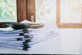 desk office file document paper. Stack Of Business Report Paper File On Modern White Office Desk With Bokeh Background. Stock Document Y