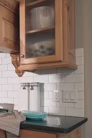 light rail used as a decorative detail on framed cabinetry