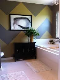 ... Gray and yellow chevron stripes create a a stylish accent wall in the  bathroom [Design: