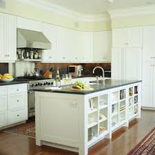 This Central Kitchen Island Includes A Raised Eating Area, Sink, Dishwasher,  And Warming Drawers. It Functions As A Serving Surface For Large Groups Or  A ...