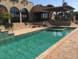 Swimming pool tiles ..6 shades of green and blue make this beautiful pool in