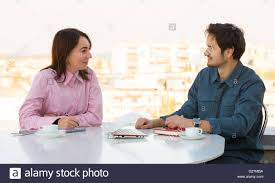 interview job chinese w stock photos interview job chinese informal business meeting at roof top cafe stock image