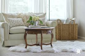 sitting room with sheepskin fur rug and vintage table