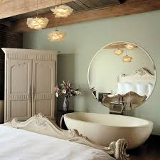 master bedroom pendant lighting with flower shaped lamp shades above paint glazed ceramic vase beside freestanding bedroom pendant lighting
