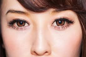 close up of a woman with brown eyes
