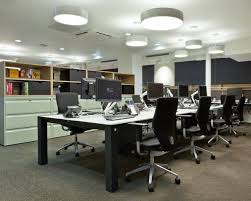 nulty waterstones piccadilly workplace illumination suspended circular light fixtures lighting design