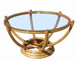 made circa 1940 this six pole rattan coffee table has an unusual stacked rattan