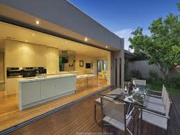 i love the way the kitchen table extends off from the kitchen island