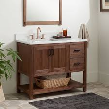 Measure from the wall to the pipe for the sink to figure out where the sink should be. Solid Wood Vanity Signature Hardware