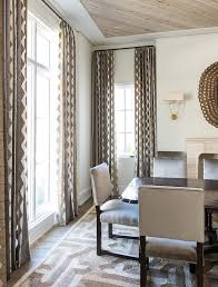 extra long dark stained dining table with gray velvet dining chairs
