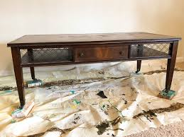 take an old coffee table and turn it into an ottoman type coffee table
